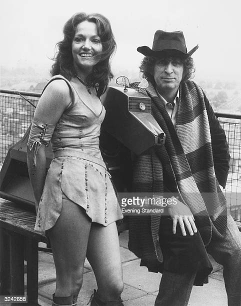 Tom Baker and Louise Jameson as they appear in Dr Who playing the fourth incarnation of the Doctor and his assistant Leela They are with K9 Dr Who's...