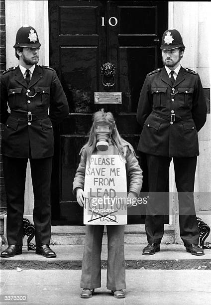 9 year old Rachel Geary stands outside No 10 Downing St wearing a gas mask and holding a banner Protesters are campaigning to stop the proposed...