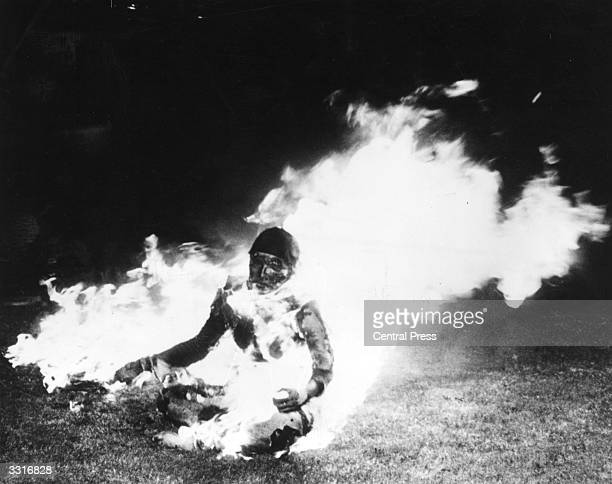 Australian heiress, Lynette Phillips in a blaze of fire outside the UN building in Geneva, during a protest against people living in luxury.