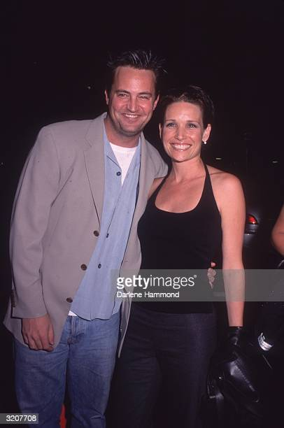 American actor Matthew Perry and Rene Ashton smiling together at the premiere of director David Fincher's film Fight Club at the Mann Village Theatre...