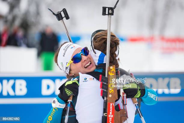 6th place Anais Chevalier of France and 1st place Justine Braisaz of France celebrate in the finish area during the IBU Biathlon World Cup Women's...