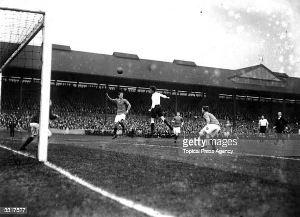 Goal mouth action puts pressure on Chelsea during their match against Tottenham Hotspur at Stamford Bridge