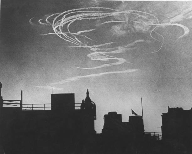 Interwoven vapour trails over London during an early...