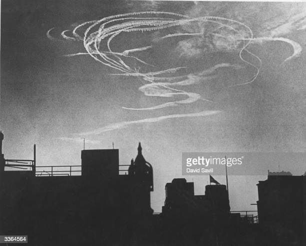 Interwoven vapour trails over London during an early morning air raid in the Battle of Britain