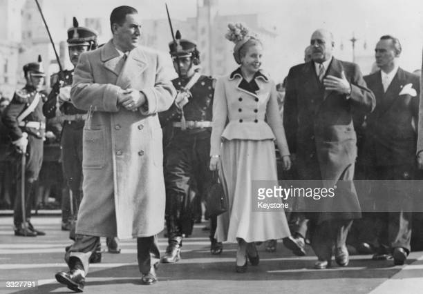 Eva Peron with her husband President Peron of Argentina and talking to General Pistarini while on their way to a Thanksgiving Day ceremony in Buenos...