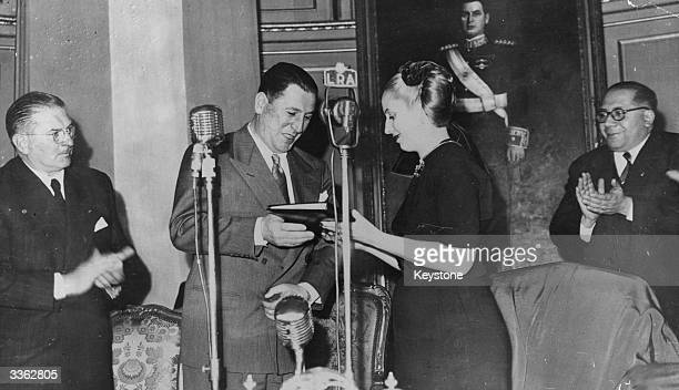 Maria Eva Peron handing over the 'Rights of Old Age' to her husband President Juan Peron in Buenos Aires Argentina Mrs Peron recently proclaimed the...