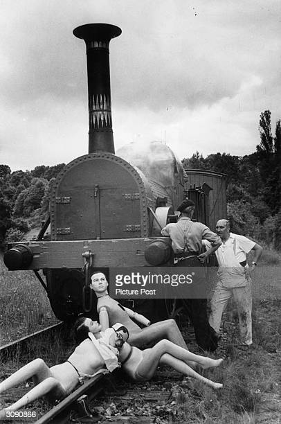 In a scene from the Ealing comedy 'Titfield Thunderbolt' dummies used for long shots wait beside the Thunderbolt 'played' by the 'Lion' a 114 year...