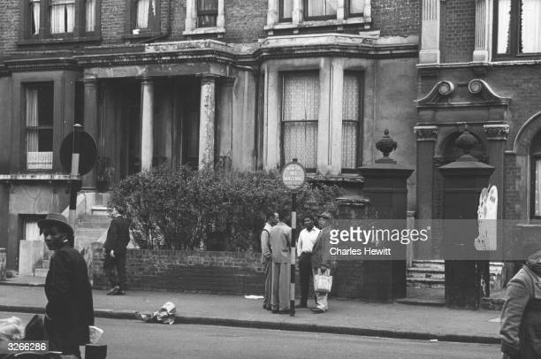Street scene in Brixton London where many immigrants have settled Original Publication Picture Post 6044 Breeding A Colour Bar pub 1952