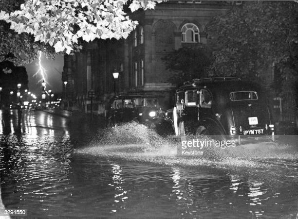 Bolt of lightning flashes in a very impressive thunderstorm which caused considerable flooding around London, including Birdcage Walk near Buckingham...