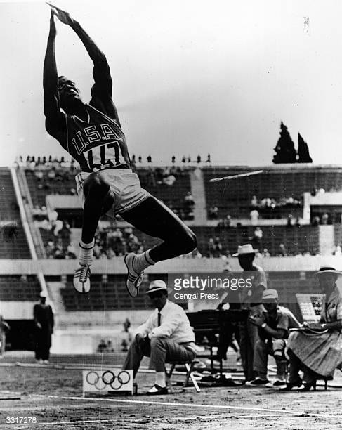 American decathlon athlete Rafer Johnson in the long jump in the Olympic Stadium, Rome.