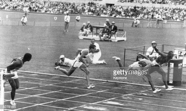 The finish of the 100m hurdles at the Olympic games in Rome in 1960 just won by Lee Calhoun from the USA ahead of Willie Mae also from the USA