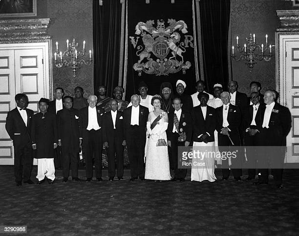 Queen Elizabeth II with Commonwealth Prime Ministers in the throne room at St Jame's Palace