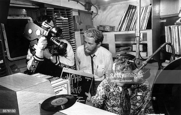 The 'World in Action' team making a program about the pirate radio ship Caroline filmed by Paddy Searle and produced by Mike Hodges The DJ being...