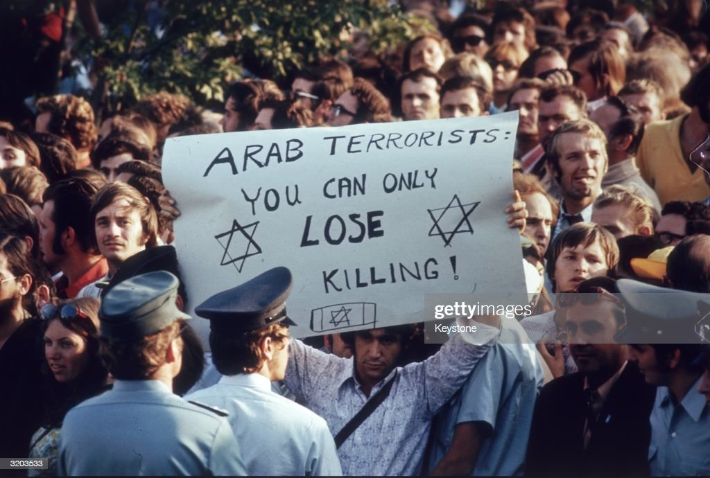 Olympic tourists and locals in Munich protesting against the actions of a group of seven Arab terrorists who held eleven members of the Israeli Olympic team hostage. All eleven were killed.