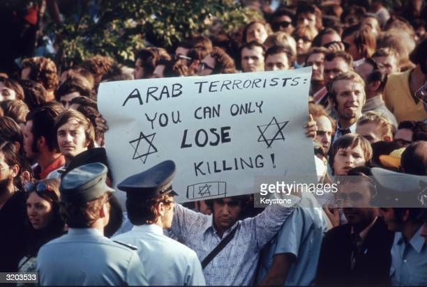 Olympic tourists and locals in Munich protesting against the actions of a group of seven Arab terrorists who held eleven members of the Israeli...