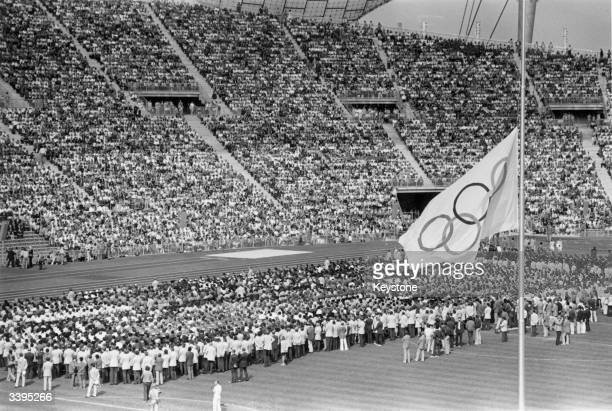 The Olympic flag flying at halfmast in the Olympic Stadium in Munich during the memorial service for the Israeli athletes who were killed by Arab...