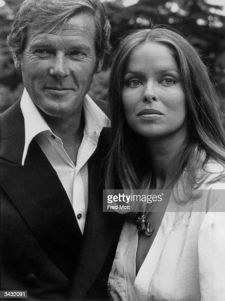Film star Roger Moore and actress Barbara Bach his costar in the James Bond film 'The Spy Who Loved Me'