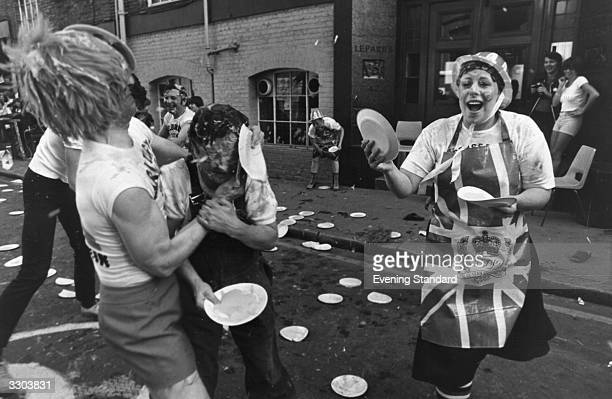 Participants from three London pubs 'Prince of Wales' 'The Freemasons' and 'Marlborough Head' take part in a custard pie fight