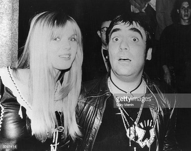 Notorious wild man of rock Keith Moon drummer of British group The Who with his girlfriend Annette WalterLax at the film premiere of 'The Buddy Holly...