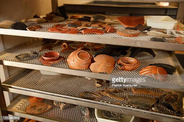 The archaelogical team clean ceramics and amphorae of the wreckArtifacts from the Arles Rhone 3 are displayed in the Arles Ancient History Museum on...