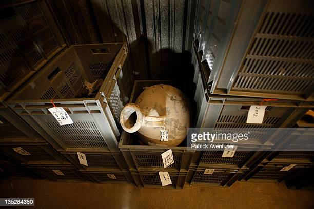 The archaelogical team clean one amphorae of the wreckArtifacts from the Arles Rhone 3 are displayed in the Arles Ancient History Museum on September...