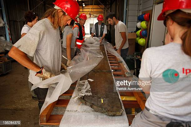 The archaelogical team work on the section of the wreckArtifacts from the Arles Rhone 3 are displayed in the Arles Ancient History Museum on...