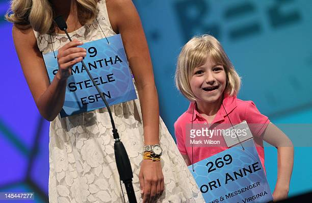 6year old Lori Anne C Madison of Woodbridge Virginia stands with ESPN reporter Samantha Steele after the second round of the 2012 Scripps National...