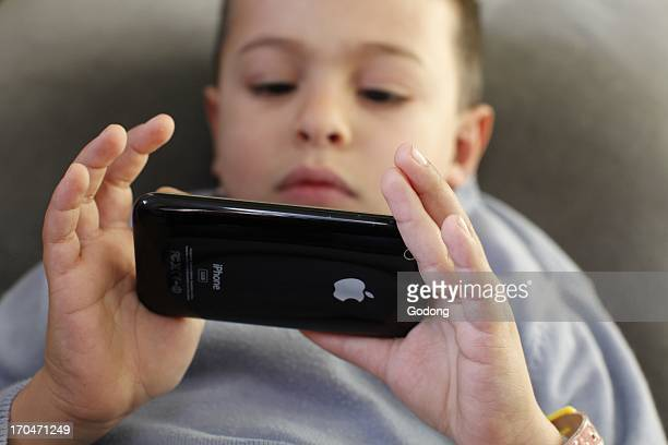 6yearold boy playing with an Iphone France