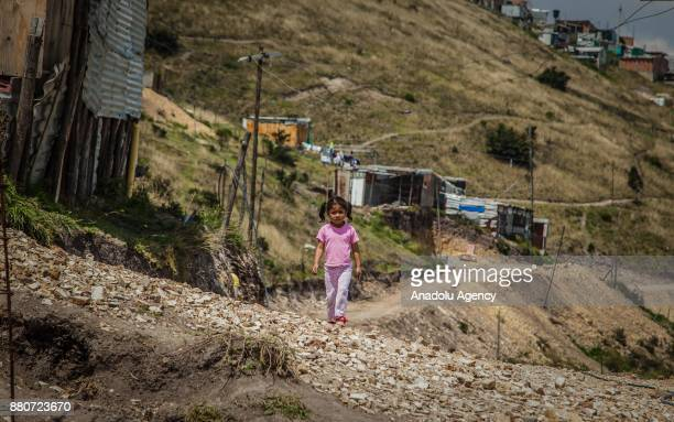 A 6yearold girl is seen walking in Ciudad Bolivar in Bogota Colombia on November 27 2017 Colombia has one of the largest population of internally...