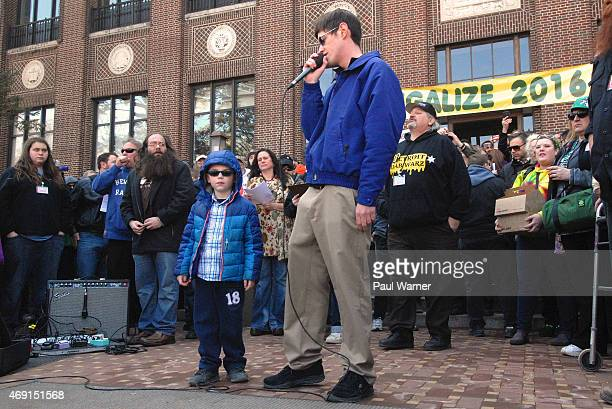 6yearold Ryan Power who suffers from a autoimmune disease stands next to his father Jim Power as he talks about how his family used cannabis oil to...