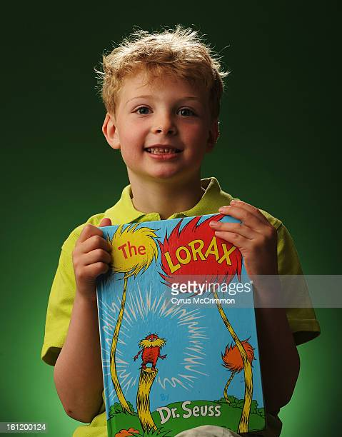 6yearold Samuel Reisch holds The Lorax book by Dr Seuss which was his inspiration for his Peeps diorama Reisch the children's winner was photographed...