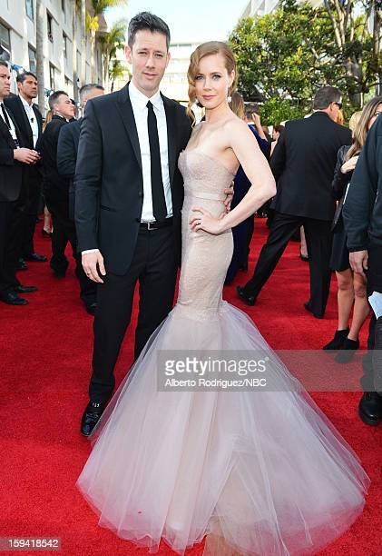 70th ANNUAL GOLDEN GLOBE AWARDS Pictured Actors Darren Le Gallo and Amy Adams arrive to the 70th Annual Golden Globe Awards held at the Beverly...