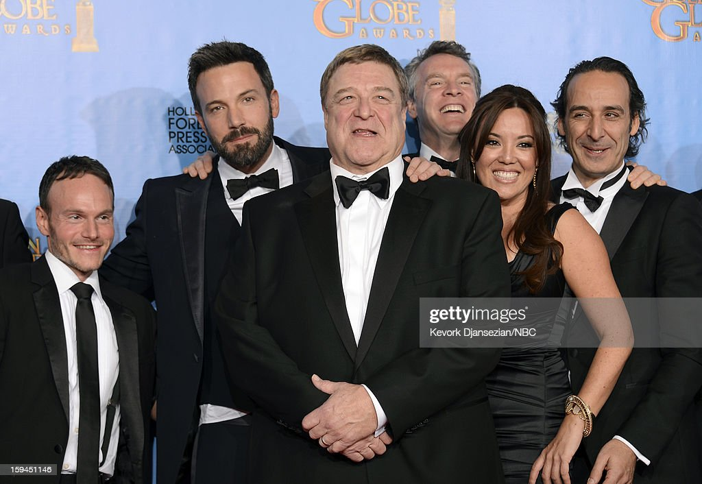 70th ANNUAL GOLDEN GLOBE AWARDS -- Pictured: (2nd from L-R) Director Ben Affleck, actors John Goodman, Tate Donovan, producer Chay Carter, and composer Alexandre Desplat of 'Argo', winner Best Motion Picture, Drama, in the press room at the 70th Annual Golden Globe Awards held at the Beverly Hilton Hotel on January 13, 2013.