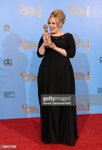 70th ANNUAL GOLDEN GLOBE AWARDS -- Pictured: Singer Adele, winner of Best Original Song - Motion Picture for 'Skyfall', poses in the press room at...