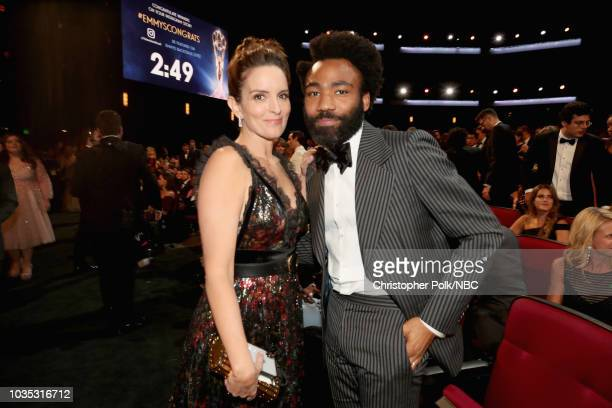 70th ANNUAL PRIMETIME EMMY AWARDS -- Pictured: Actors Tina Fey and Donald Glover attend the 70th Annual Primetime Emmy Awards held at the Microsoft...