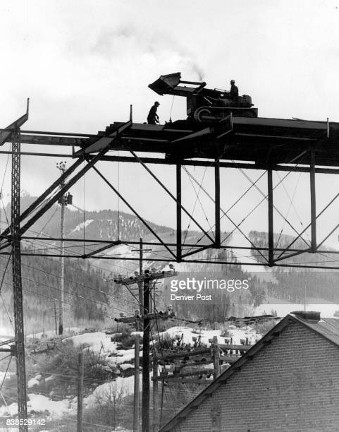YearOld Bridge Scrapped at Aspen Members of a wrecking crew from the M C Jacobs Construction Co Denver remove planking from a highway bridge across...