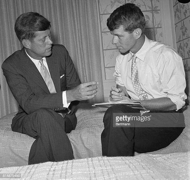Los Angeles, CA: Sen. John F. Kennedy, front running candidate for the Democratic Presidential nomination talks things over with his brother and...
