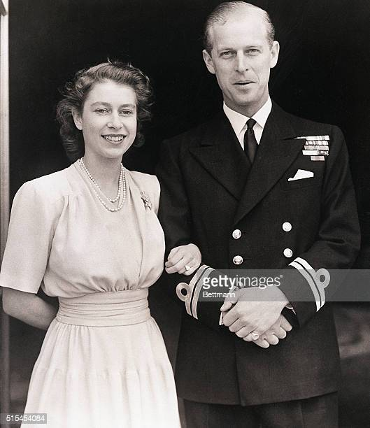London, England- Princess Elizabeth, Britain's future queen, and Lt. Philip Mountbatten shown at Buckingham Palace. On her engagement finger, the...