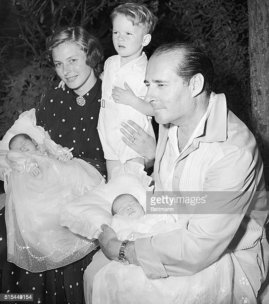 Rome, Italy- Actress Ingrid Bergman and her husband, director Roberto Rossellini, pose at home in Rome for the first family portrait that includes...