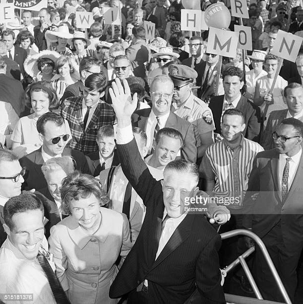 7/11/1964San Francisco CA Governor George Romney waves happily as he arrives for the GOP convention Romney's wife Lenore stands beside the Michigan...