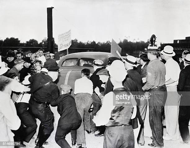 7/11/39Pontiac Michigan Policemen tussle with pickets as disorder breaks out at the gates of the Pontiac Fisher Body Plant The policemen were...