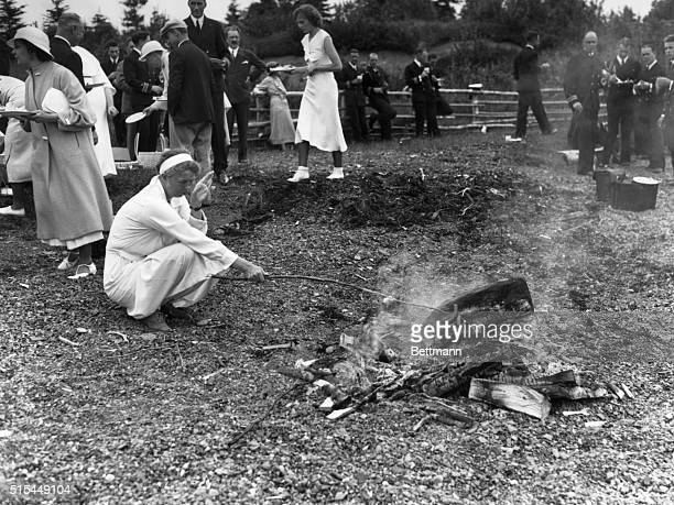 7/1/1933Campobello Island New Brunswick Canada A picnic is a picnic anywhere and even the First Lady of the land roasts frankfurters like any other...