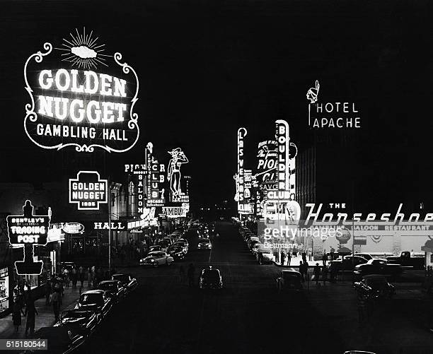 7/1/1953Las Vegas NV Neon signs advertising the legalized gambling establishment in downtown Las Vegas light up the night sky But gambling is a...