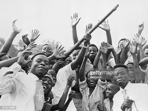 Leopoldville, Congo-A group of Congolese wave guns, whoop and shout for joy during the Independence celebrations.