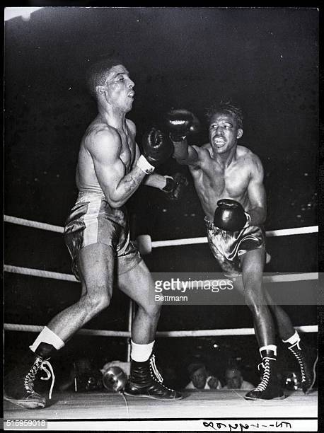 7/12/1951London England Randolph Turpin left sways back from a right swung by Sugar Ray Robinson during their title bout at Earl's Court London July...