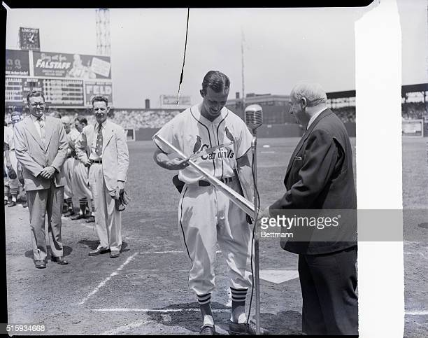 St. Louis, MO: National League President Warren Giles presents to a smiling Stan Musial the slugger's fifth silver bat, for winning the 1951 National...