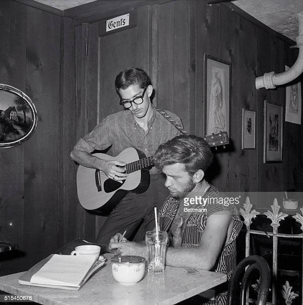 7/13/1959New York NY Don Stewart plays guitar as Dick Woods writes poetry in the Gaslight coffee house in Greenwich Village At places like the...