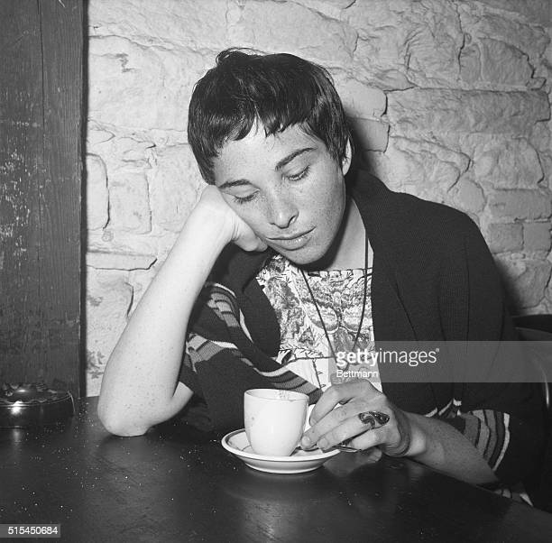 7/13/1959New York NY Eddy Slaton sits at a table with espresso coffee in front of her in the Gaslight coffee house in Greenwich Village A setting for...