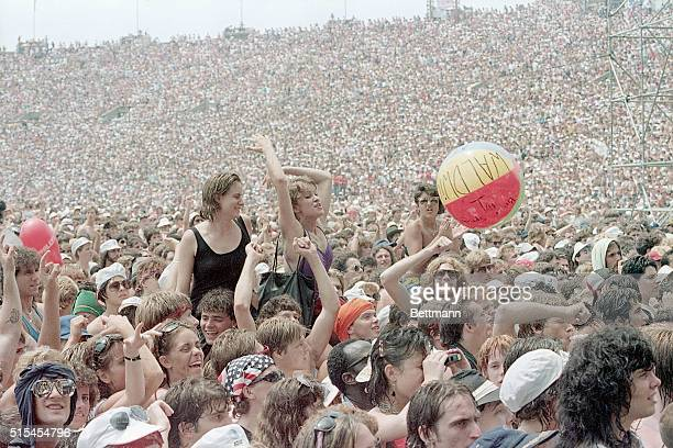 7/13/1985Philadelphia PA Some of the 90000 rock fans watching the Philadelphia portion of the Live Aid concert at JFK Stadium bounce a beach ball...