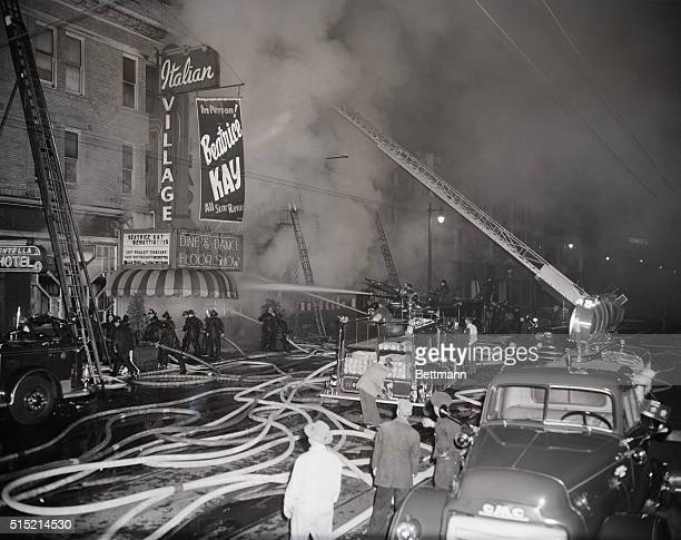7/13/55San Francisco California Firemen battle a spectacular fouralarm blaze in the heart of North Beach here early July 11th The fire destroyed a...